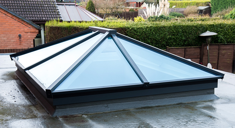 Bespoke rectangular roof lantern sits centerally in this orangery extension