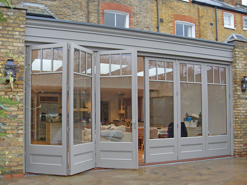 3m high doors help daylight flood into this orangery extension