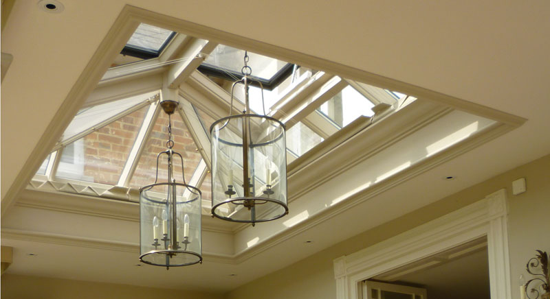 Pendant lighting hung from a roof lantern
