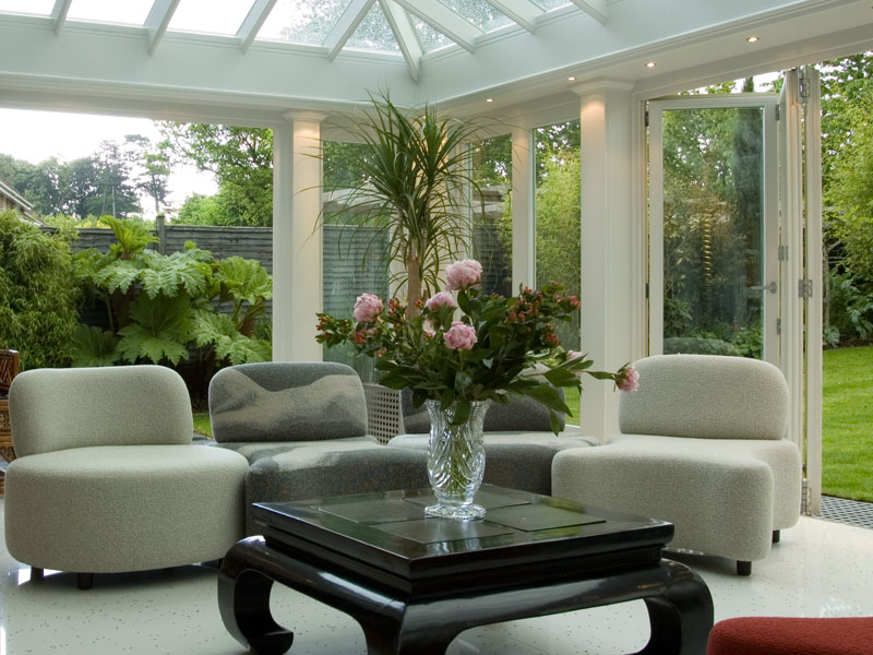Soft seating and a table and chairs in an orangery extension