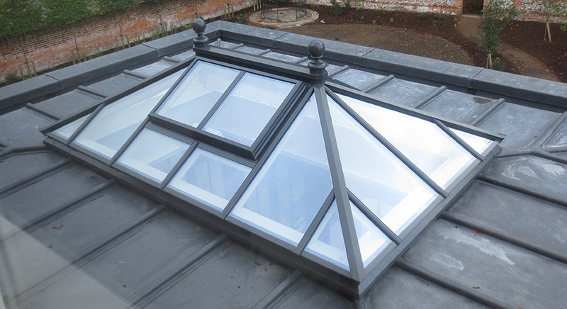 Roof lantern as part of an orangery extension in slate grey