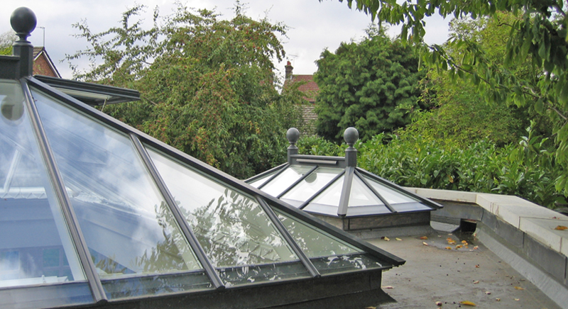 Bespoke rectangular roof lanterns add light to create an exciting space below.