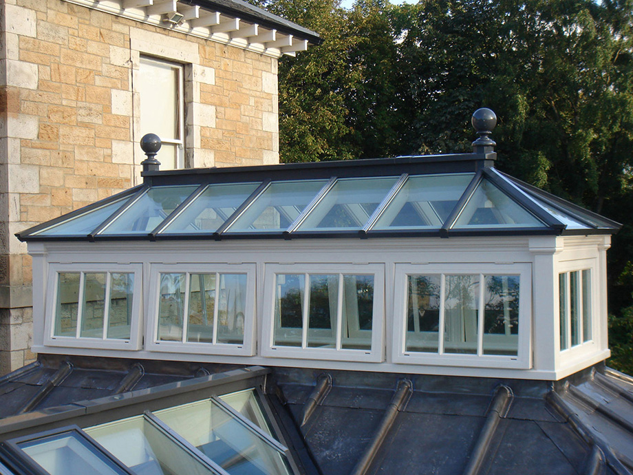 Beautiful roof lantern with side frames crowning a lead roof
