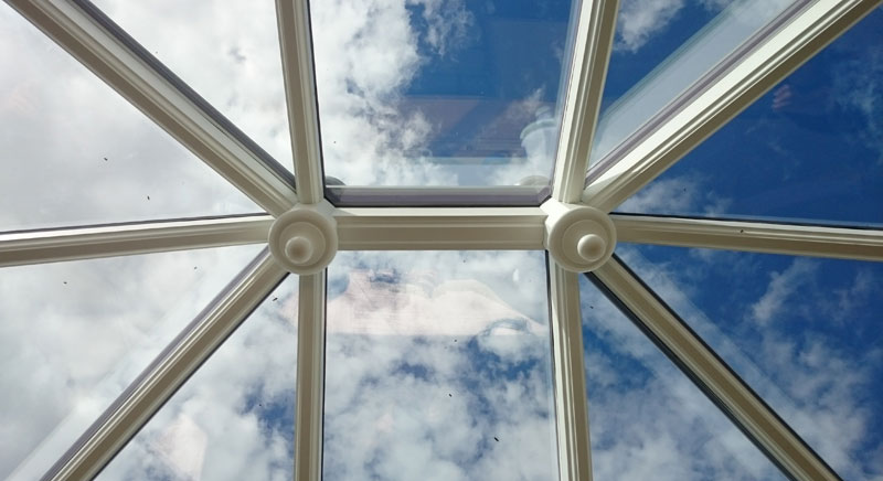 Looking into the sky through a roof lantern