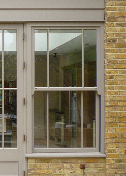 Traditional cord and weights sash window as part of an orangery